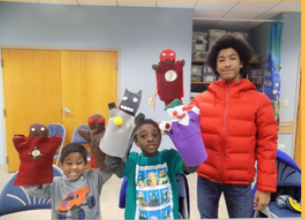 Kids with superhero puppets
