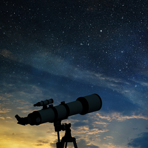 telescope silhouetted by the night sky