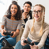 Small group of teens playing video games