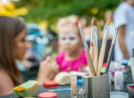 child with face paints