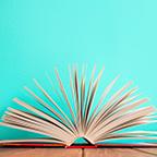 An open book on a cyan background