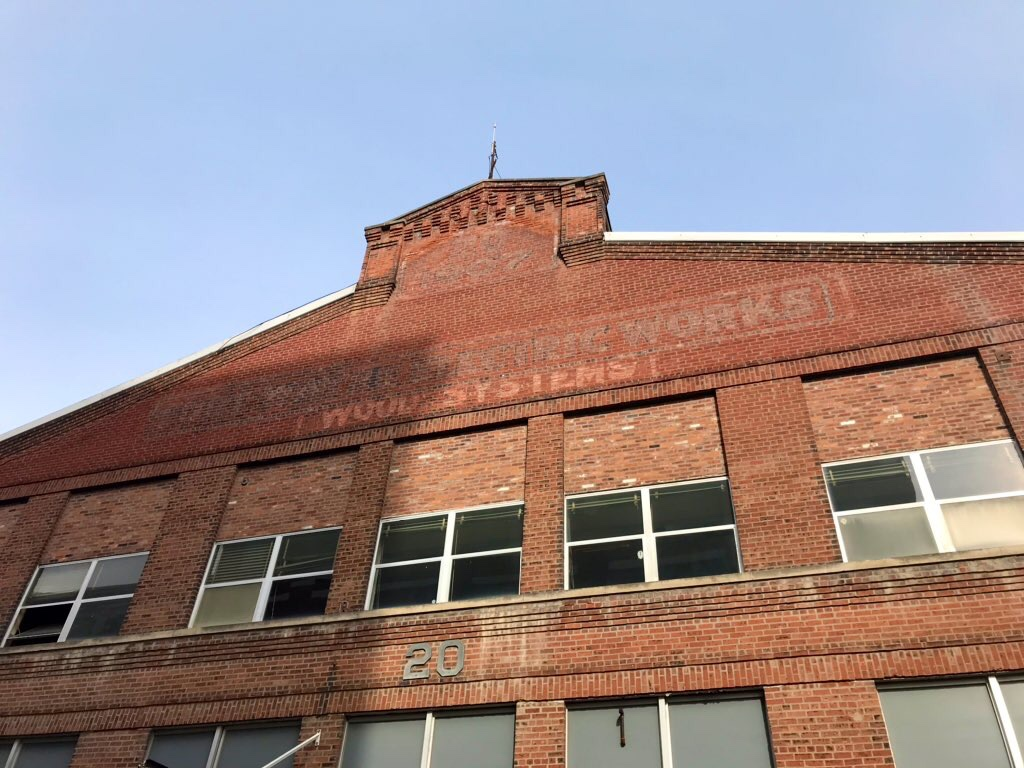 Faded signage on building exterior