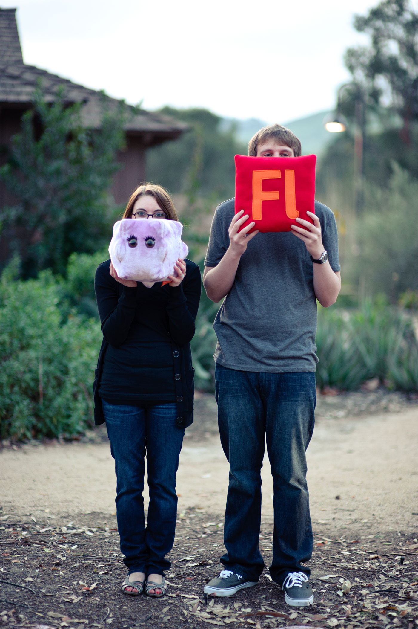Photo of myself holding a pillow with the Flash logo on it and my then-fianceé (now-wife) holding a pillow in the shape of the Epstein–Barr virus