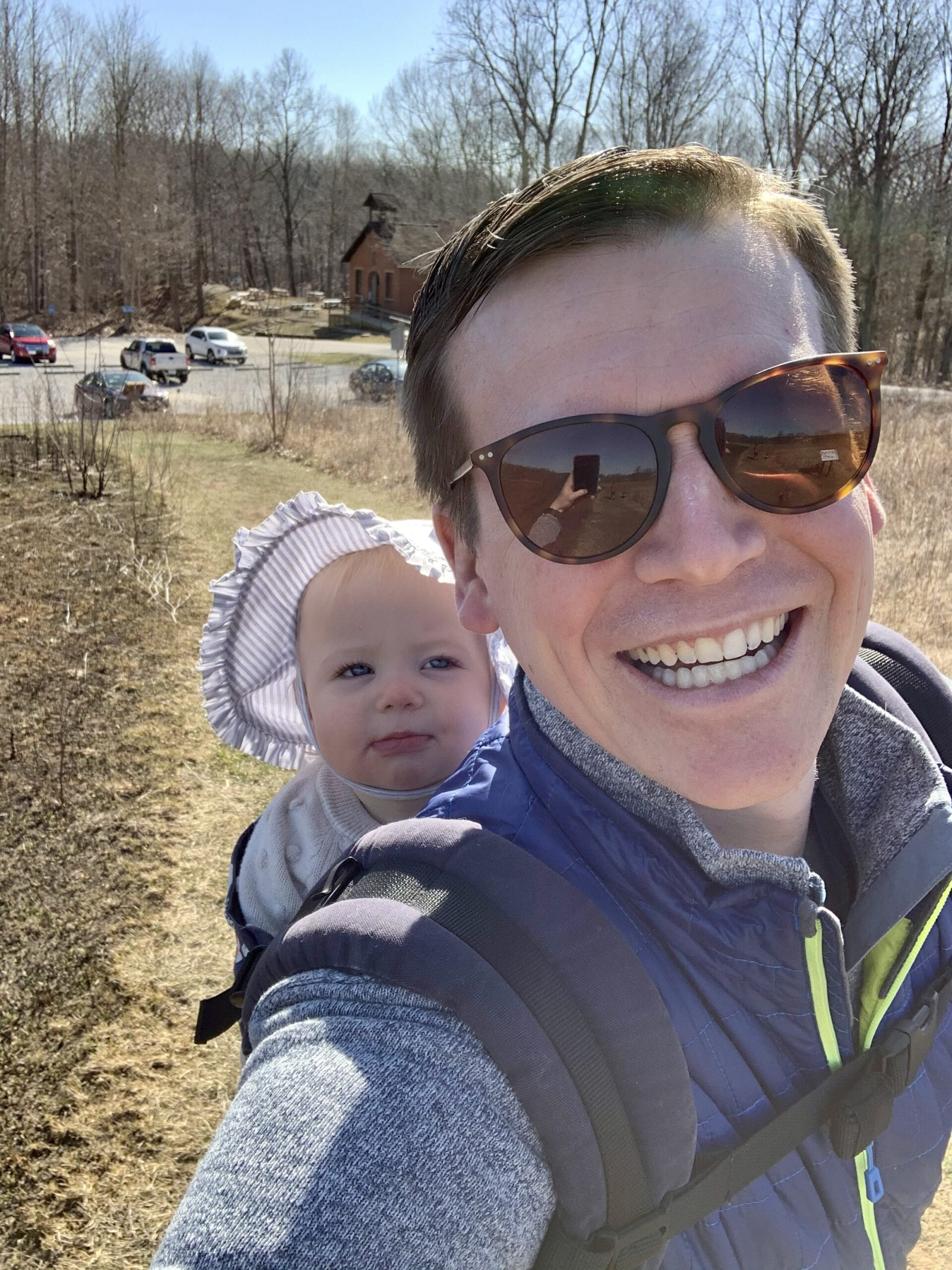 Selfie of me hiking with my daughter riding along in a baby carrier