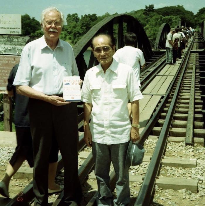 two men at a bridge