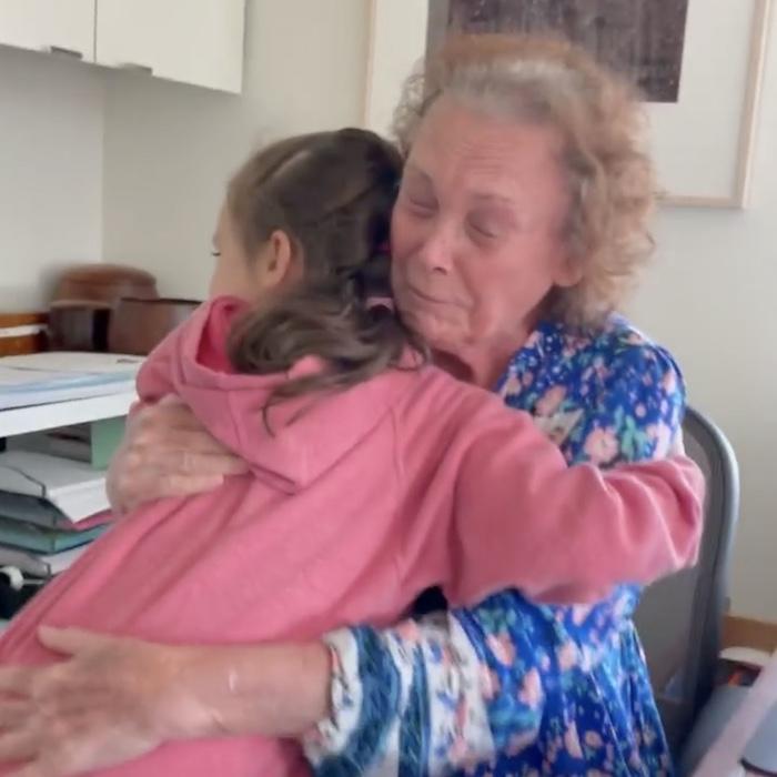 granddaughter hugging grandma