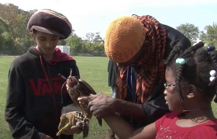 man showing bird to kids