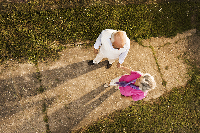 High angle view of a smiling senior couple taking a walk in nature and communicating.