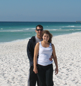 Melissa and fiancé at their beach wedding site
