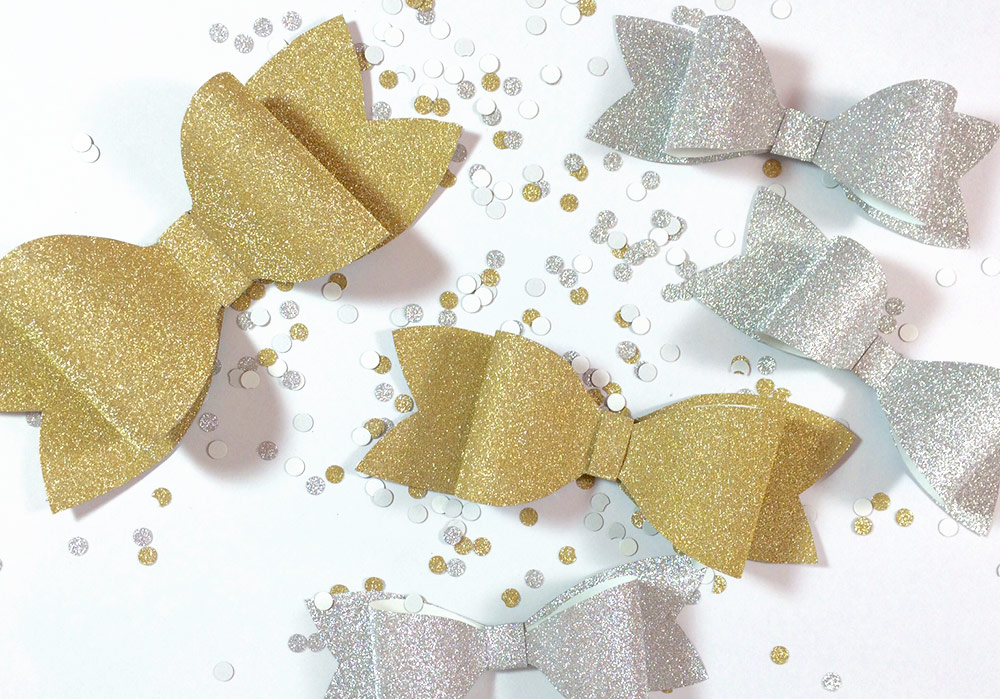 DIY silver and gold glitter paper bows by Allie & Elle. Step by step instructions in post