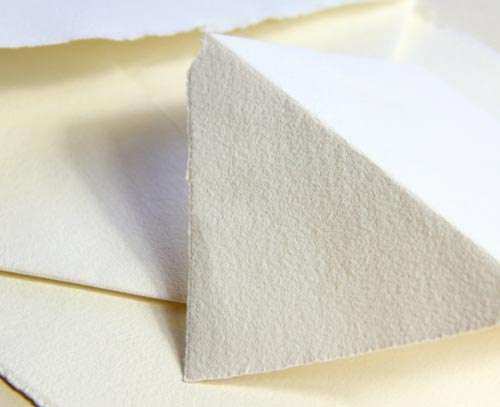 Handmade paper and envelopes with soft texture and hand torn deckled edges
