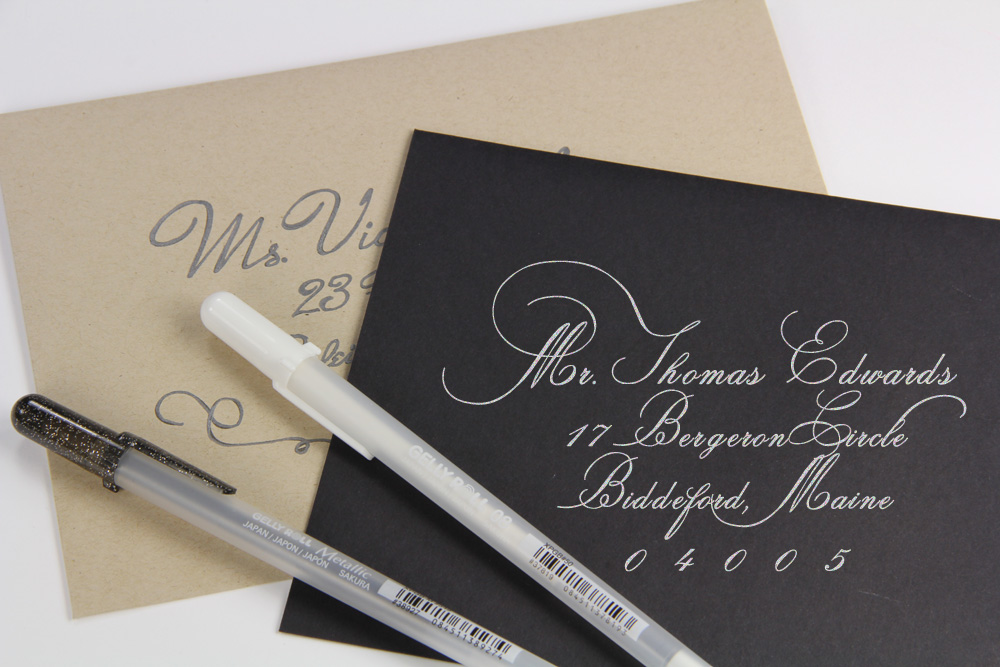 black and kraft brown envelopes addressed with calligraphy