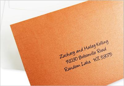 metallic orange response envelope printed in sharp vivid text