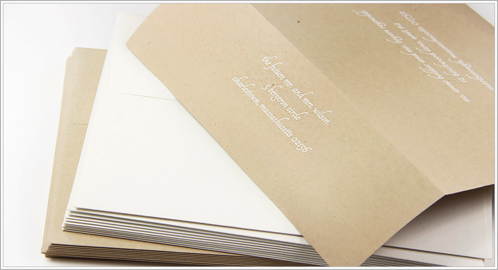 White ink printed on Desert Storm kraft envelopes in white ink - Tangerine font