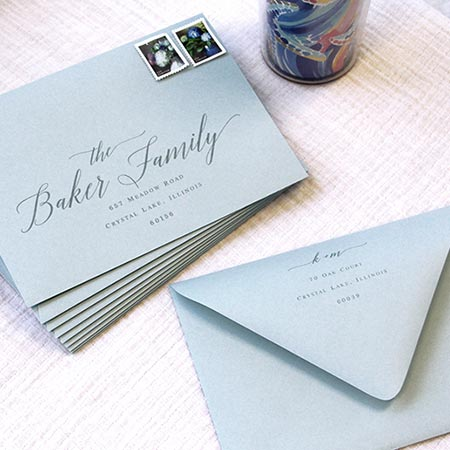 Dusty blue wedding envelopes printed with calligraphy font