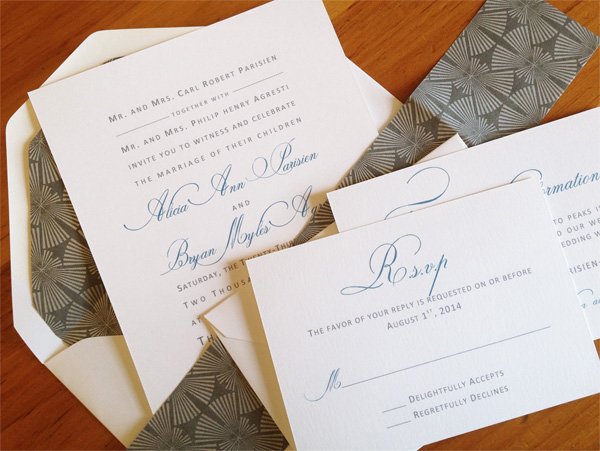 gray and white wedding invitation ensemble with elegant typography