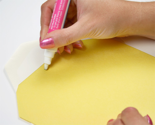 Glue envelope liner into envelope with a small amount of glue