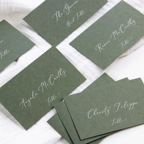 Dusty green wedding place cards printed in white by LCI Paper