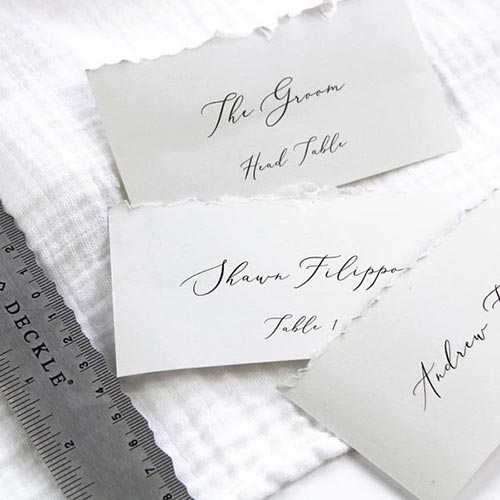 Hand deckled flat place cards. Print and cut at home using printable place card template.