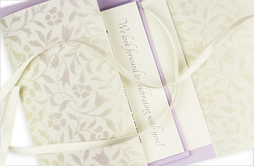 wedding invitation with cream floral patterned vellum wrap