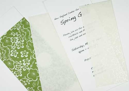 invitations wrapped in decorative pearlized paper