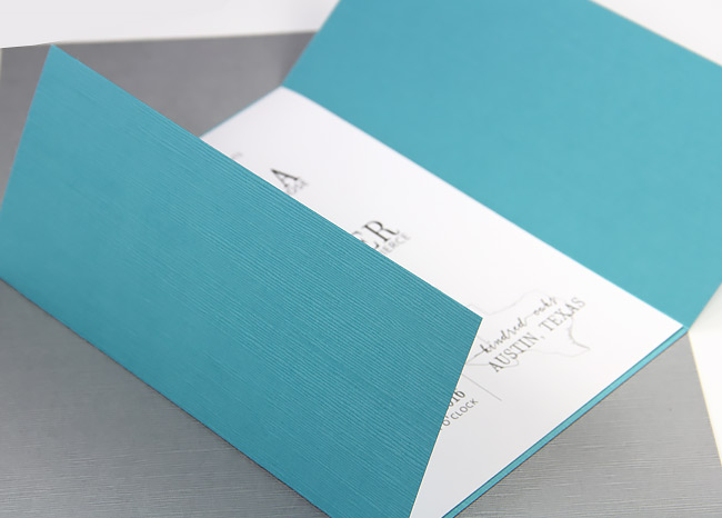 Invitation wrapped in Japanese linen textured gate fold