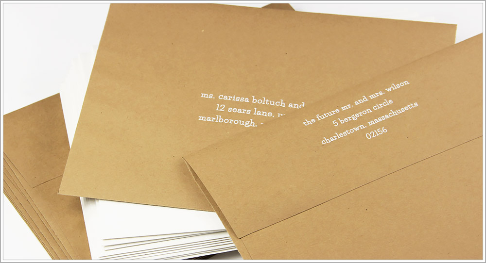 White addressing on Grocer Kraft envelopes in lowercase Lifesavers font