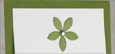 Herbeus green menu card with green flower embellishment