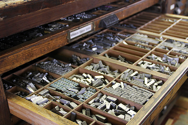 Trays of metal type letters and ornaments