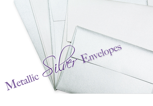 Close up array of silver metallic envelopes