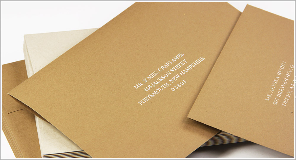 Matching kraft envelopes printed with white ink in Playfair Display font