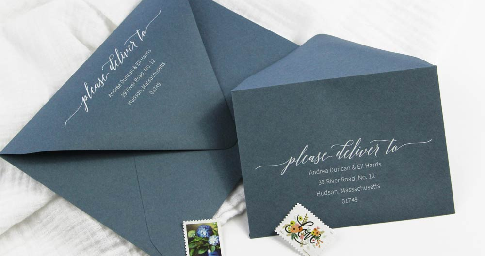 Dusty blue envelopes printed with white ink. Download free wedding return address template from LCI Paper. Customize and print in black at home or order printed in white from LCI Paper