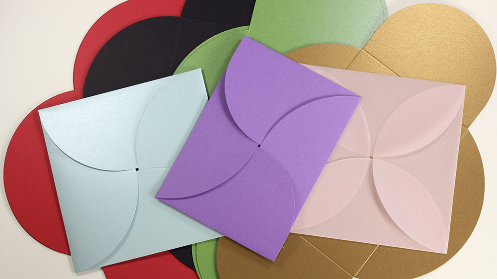 Pochette invitations enclose a card within 4 petals and are offered in a variety of sizes, colors, and finishes. Call or shop online at LCIPaper.com