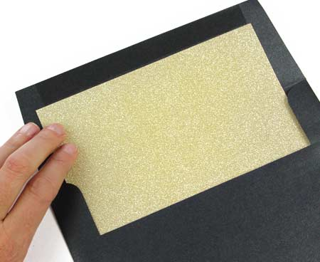 How to line your own envelopes - Glue glitter liner into envelope and press firmly into place.