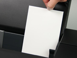 loading rsvp-wedding response envelopes into printer