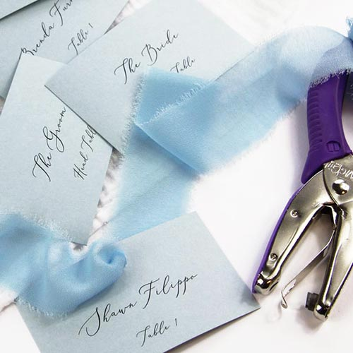 Dusty blue flat place cards with ribbon. Free word template, instructions, cardstock from LCI Paper