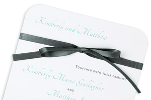 Round corner wedding invitation with tied satin bow