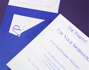 rsvp card behind stack in pocket invite