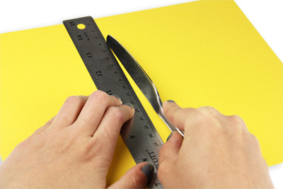 Score card stock with butter knife