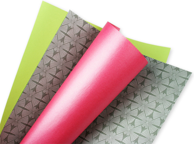 sheets of colorful text weight paper