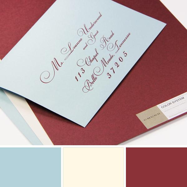 Vanilla, Merlot, Placid Blue wedding color scheme displayed with printed wedding envelope