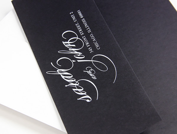 white printing on black envelopes