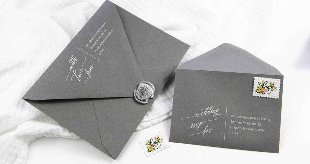 Gray envelopes printed in white ink from LCI Paper. Download free wedding calligraphy return address template, customize in word. Print on your choice of envelopes.