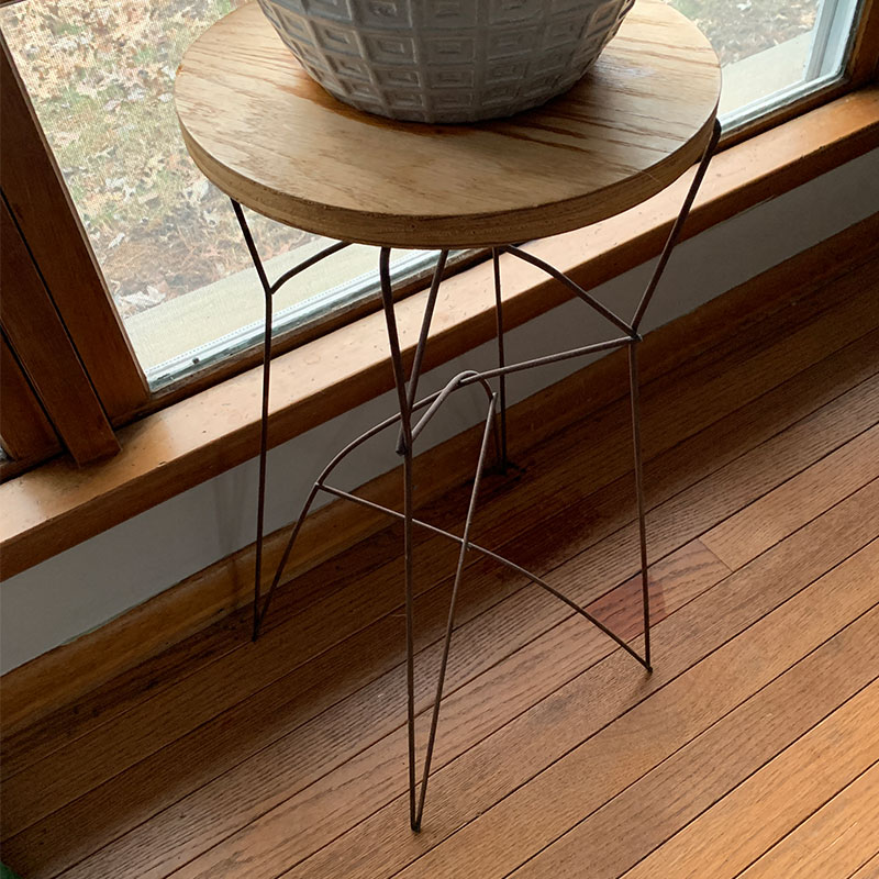 Small meta stool with a plan setting on it