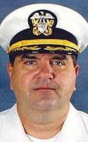 Navy Cmdr. Adrian B. Szwec