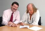 Tavener renews contract