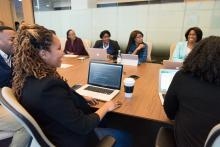 a conference room with a diverse group of people around the table