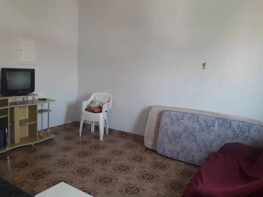 Sala do kitinet com  dormitórios em Boqueirão - Praia Grande