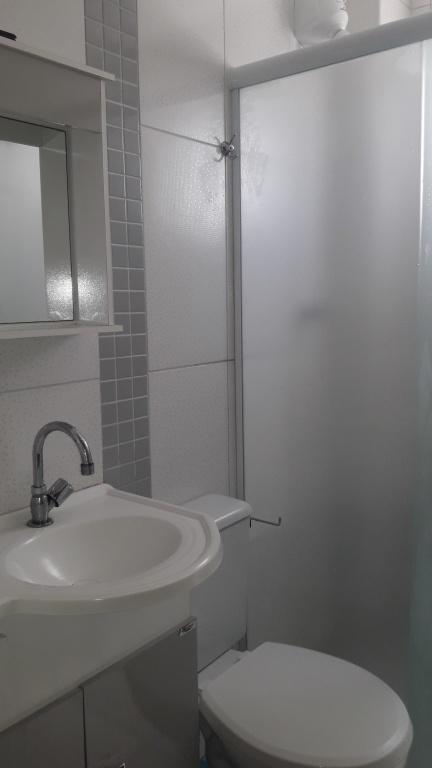 Suíte do apartamento com 2 dormitórios em Balneário Maracanã - Praia Grande