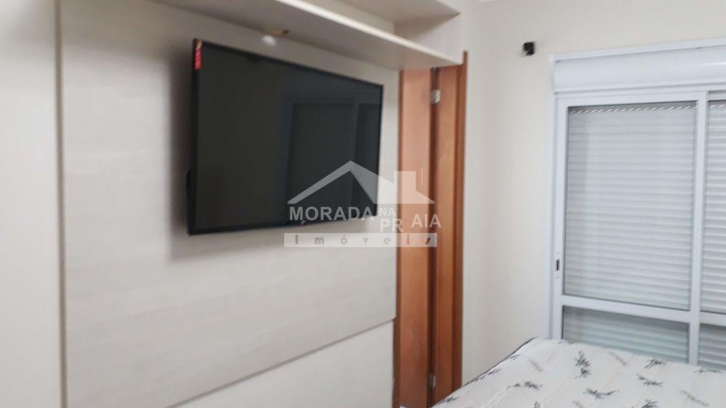 Suíte do apartamento com 2 dormitórios em Boqueirão - Praia Grande